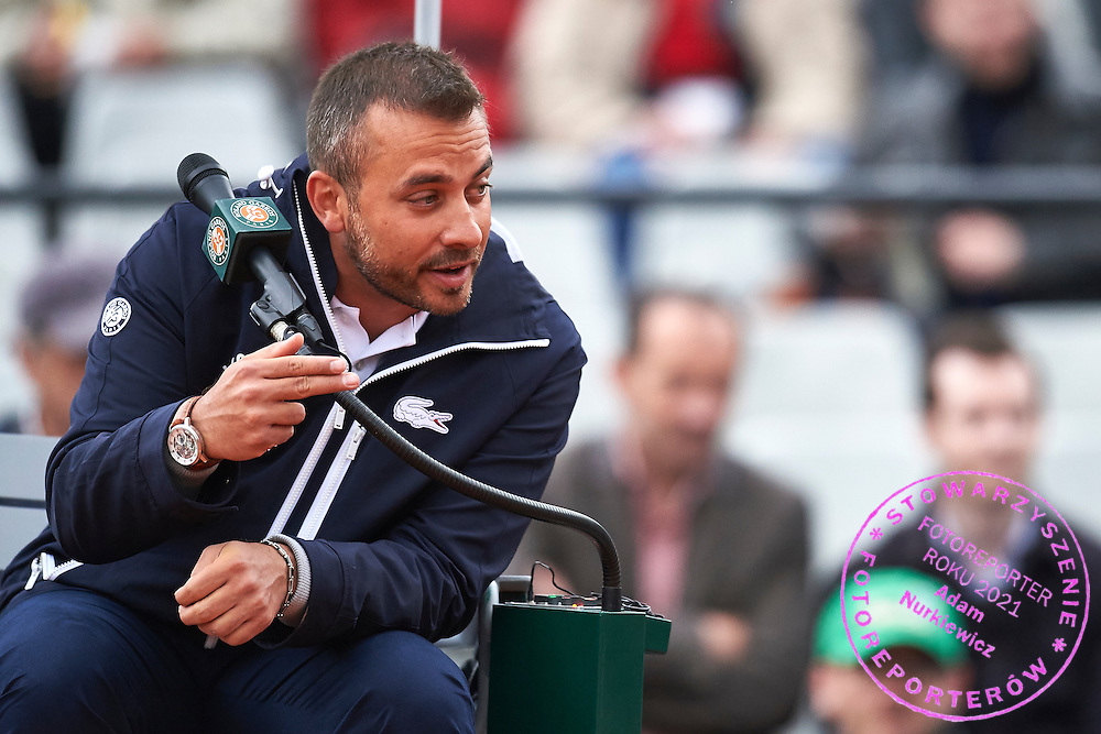 Paris, France - 2016 May 23:  Tennis Chair Umpire Damiano Torella speaks while women's single match Round 1 during tennis Grand Slam tournament The French Open 2016 (also called Roland Garros) at Stade Roland Garros  May 23, 2016 w Paris, France.<br /> <br /> Adam Nurkiewicz declares that he has no rights to the image of people at the photographs of his authorship.<br /> <br /> Picture also available in RAW (NEF) or TIFF format on special request.<br /> <br /> Any editorial, commercial or promotional use requires written permission from the author of image.<br /> <br /> Mandatory credit:<br /> Photo by &copy; Adam Nurkiewicz
