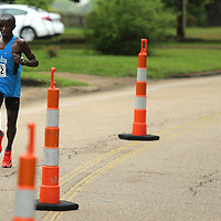 The lead runner pass the cones set up on Clayton Ave during the Gumtree Run Saturday morning in Tupelo.