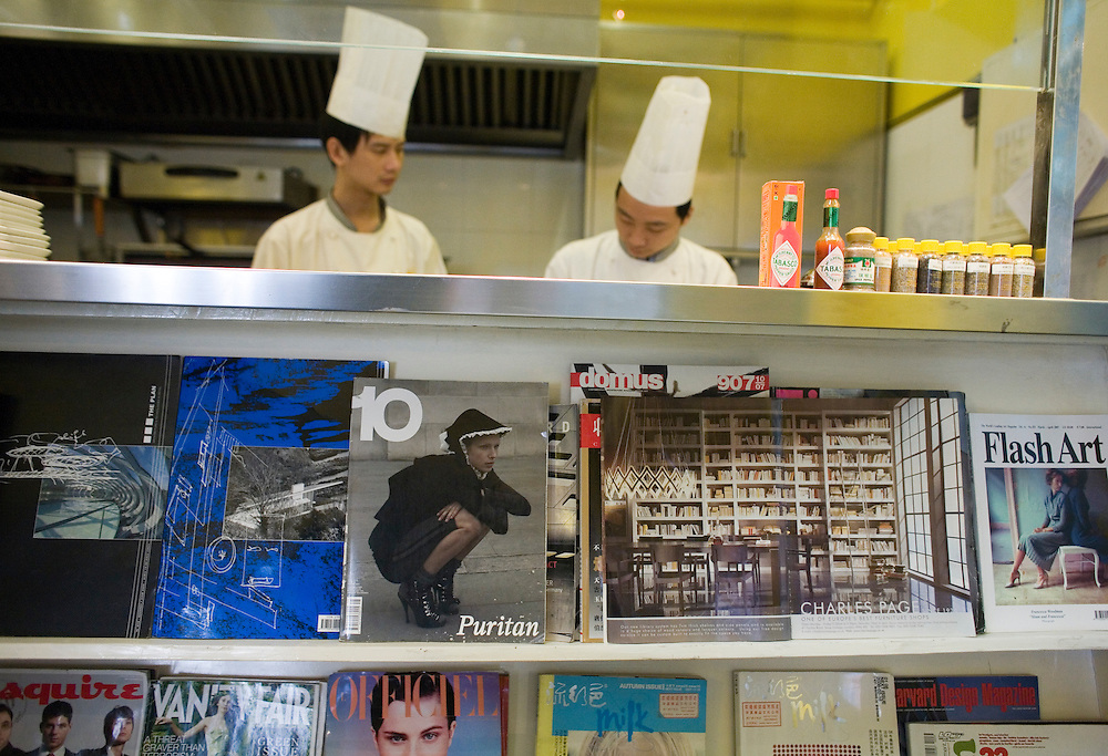 Chefs work in the kitchen at the Timezone 8 bookstore and restaurant in the 798 art district.