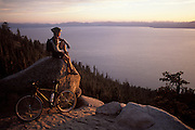 A mountain biker enjoys a view of Lake Tahoe from the Great Flume Trail near Spooner Summit on the lakes east shore.