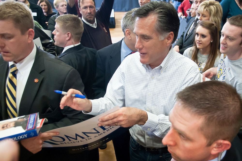 Lathan Goumas | MLive.com..February 25, 2012 - Republican presidential candidate Mitt Romney signs items after speaking at Kettering University in Flint on Saturday. After his speech Romney briefly visited with supporters who had come to hear his remarks.