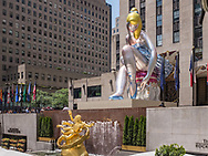 "Prometheus and Jeff Koons' '""Seated Ballerina"" inflatable sculpture at Rockefeller Center."