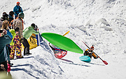 Competitors in the annual Kayaks on the Snow race down a flume of snow to splash and paddle a makeshift pond to the finish - while skiers and riders take the next to last day of the ski season to cheer them, occasionally dodging huge splashes and flying kayaks.