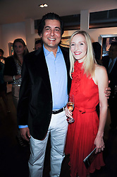 ASHWAN KHANNA and RUTH POWYS at a private view of Sacha Jafri's paintings entitled 'London to India' held in aid of The Elephant Family charity at 23 Macklin Street, Covent Garden, London on 3rd June 2010.