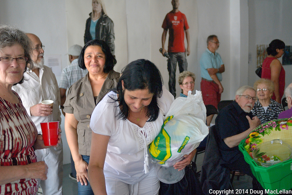 About twenty people meet with the Cuban Cousel General to Canada at the annual Cuban Canadian Freindship Association Windsor pre meeting prior to the public one at Artcite Inc. The event is part of MayWorks.