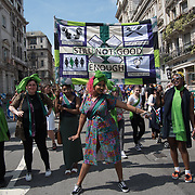 "London, England,UK. 10 June 2018. 50:50 to march together at ""Processions"" a celebration of 100 years of Women getting the vote, march through London."