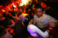 People dance to a live salsa band in the Zona Rosa, an area of nightclubs and restaurants in north Bogotá on October 5, 2007. Salsa is one of the most popular forms of music in Colombia and throughout most of Latin America. (Photo/Scott Dalton)