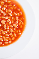 Cropped shot of plate full of beans
