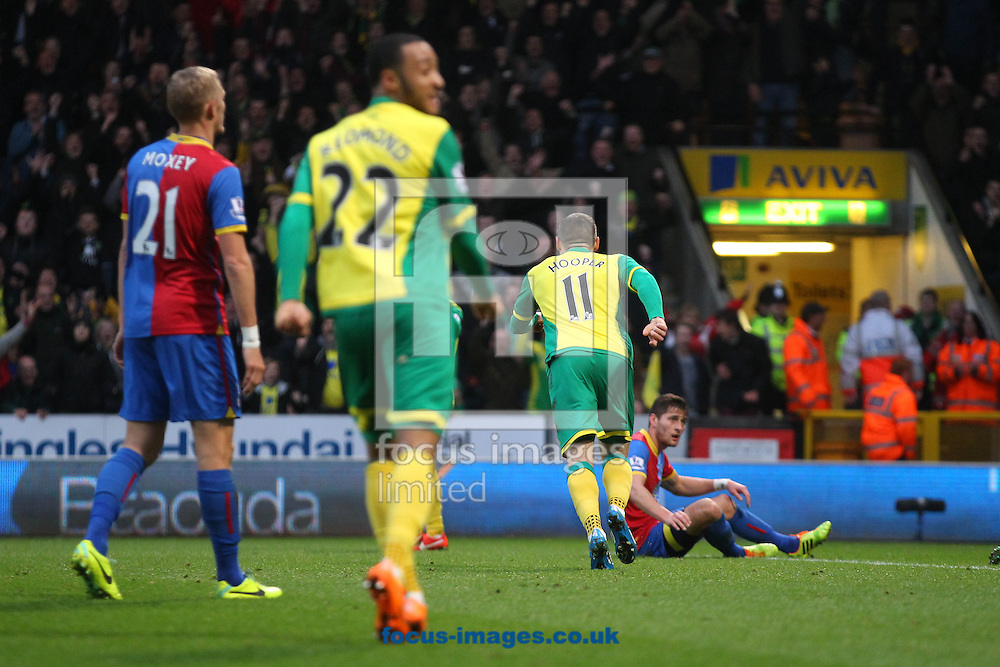 Picture by Paul Chesterton/Focus Images Ltd +44 7904 640267<br /> Gary Hooper of Norwich looks back at Nathan Redmond of Norwich who crossed the ball for his goal before wheeling away to celebrate during the Barclays Premier League match at Carrow Road, Norwich.