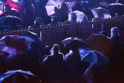 © Licensed to London News Pictures. 24/08/2013. London, UK . The Torrential rain did not dampen the spirit of the audience who joined in with Jerusalem and Rule Britannia, despite very heavy rain. The Royal Choral Society together with the Royal Philharmonic Concert Orchestra, performs an evening of the choral classics in Heavy rain at Live by the Lake. The English Heritage concert season returns to Kenwood House in Hampstead, London, with Live by the Lake. The season includes Suede, a Choral Greats concert, Keane, an outdoor live screening of Singin' in the Rain featuring the Royal Philharmonic Concert Orchestra, Opera Alfresco and an evening of Gershwin. . Photo credit : Stephen Simpson/LNP