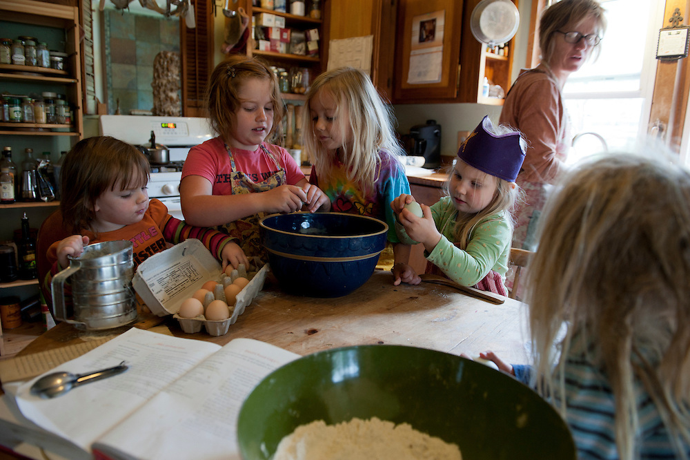"Children attending Missy Whaley's Waldorf School bake a cake with local ingredients, including spelt flour from Starline Organic Farm, eggs from Michelle McGarth and milk from Snowville Creamery. Missy also uses Frankferd Farms buying club as another source for food. According to Missy, ""being at home, allows you to educate children in how to do things like the dishes and sweeping the floor. You do teach by example, not by saying it. Giving them a safe place to play out roles of what they see. I want to live at Currents because people here have good intentions and the children will see that as an example."""