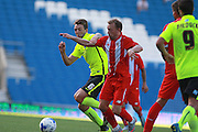 Dale Stephens battles for possession with Michael Krohn-Dehli during the Pre-Season Friendly match between Brighton and Hove Albion and Sevilla at the American Express Community Stadium, Brighton and Hove, England on 2 August 2015. Photo by Bennett Dean.