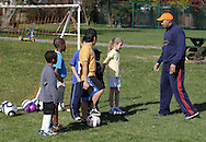 Middletown, New York  - A coach talks to children during a soccer program at the Middletown YMCA on April 14, 2012.