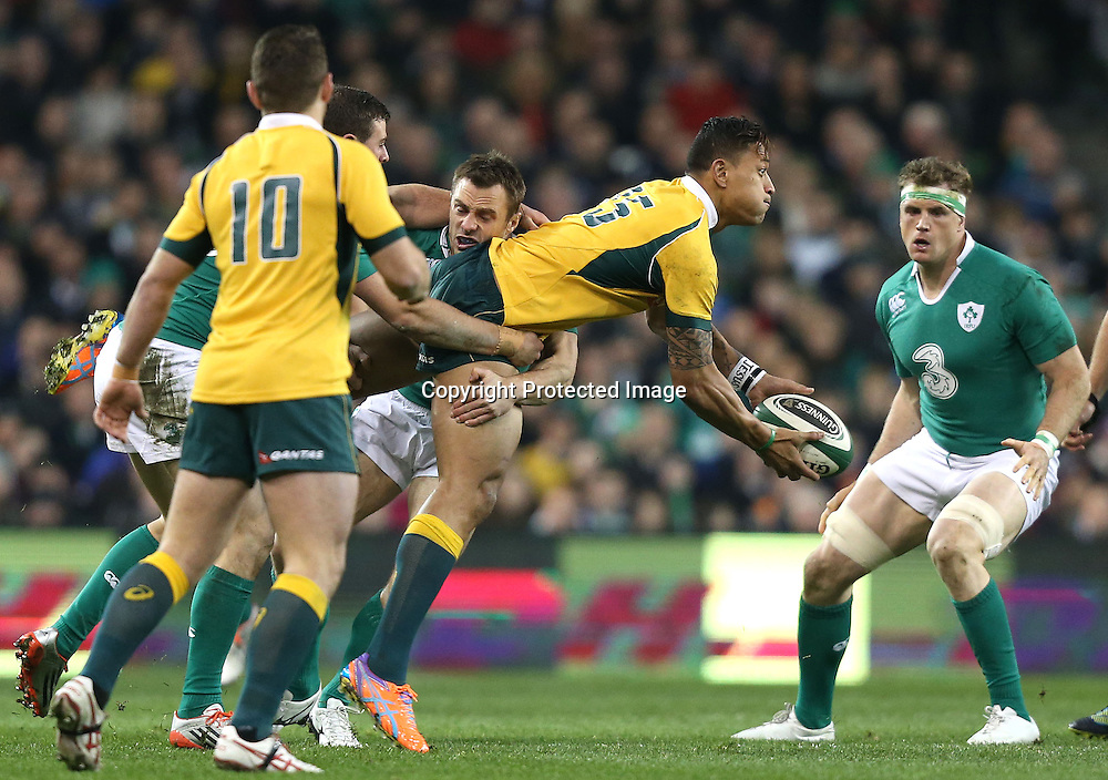 Guinness Series, Aviva Stadium, Dublin 22/11/2014<br /> Ireland vs Australia<br /> Australia&rsquo;s Israel Folau is tackled by Tommy Bowe of Ireland<br /> Mandatory Credit &copy;INPHO/Colm O'Neill