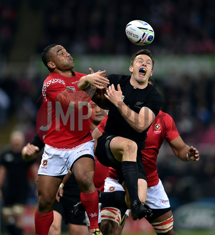Fetu'u Vainikolo of Tonga competes with Ben Smith of New Zealand for the ball in the air - Mandatory byline: Patrick Khachfe/JMP - 07966 386802 - 09/10/2015 - RUGBY UNION - St James' Park - Newcastle, England - New Zealand v Tonga - Rugby World Cup 2015 Pool C.