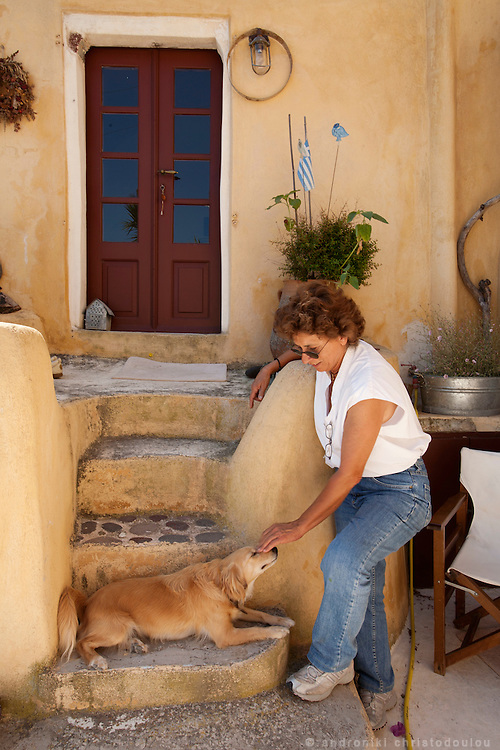 SANTORINI ISLAND - GREECE.Friderika is a painter and her themes are traditional Greek. She lives in the last remained traditional village in the island of Santorini, that is called Finikia. Her house was an old winery building that she transformed to a contemporary house while keeping the traditional architectural style of Santorini.