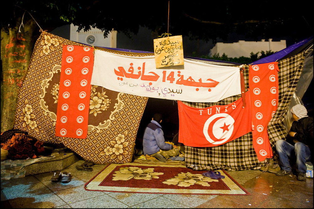 "Protesters of the 'Caravan of Freedom' continue their sit-in on the Kasbah square in Tunis, Tunisia on January 27, 2011. Protesters said they will continue their sit-in until the fall of the interim Government and satisfaction of their demands for decent life. Copyright Benjamin Girette /// On january the 14th 2011, Zine el-Abidine Ben Ali President of Tunisia and his famous wife Leila Trabelsi as know as ""The regent of Carthage"" are forced by thousands of protesters to escape the country after 24 years of power. As a result a new democraty is in design for the next six months until Tunisians organize national democratic elections, it might be the birth of the first democraty in the arab world.."