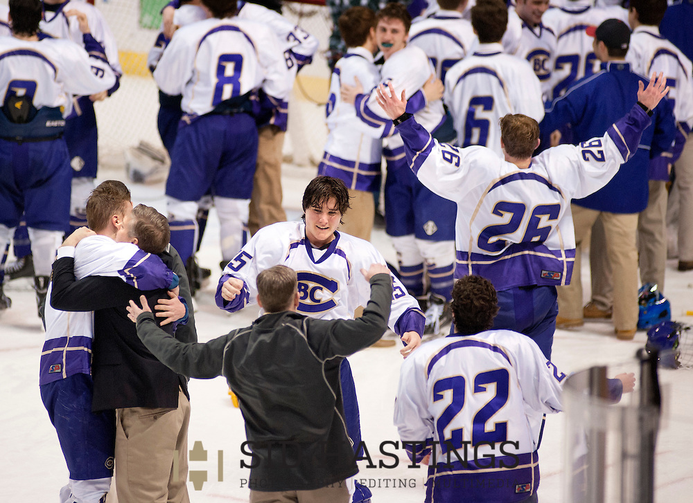 26 FEB. 2016 -- ST. LOUIS -- Hockey players form Christian Brothers' College High School, including Bud Winter (25), Trevor Wilhelm (22) and Andy Willis (26) celebrate after beating St. Louis University High School 5-2 to win the MSCHA Challenge Cup championship game at Scottrade Center in St. Louis Friday, Feb. 26, 2016. Photo © copyright 2016 Sid Hastings.