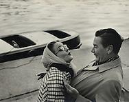 Errol Flynn and his wife Patricia in front of the boat she gave him on his birthday in Paris on the Seine river.<br /> <br /> Errol Flynn et son &eacute;pouse Patricia en face du bateau qu'elle vient de lui offrir pour son anniversaire &agrave; Paris, sur la Seine