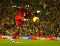 Photo: Aidan Ellis.<br /> Liverpool v Tottenham Hotspur. The Barclays Premiership.<br /> 14/01/2006.<br /> Liverpool's Momo Sissoko fires in a shot that was excellently saved by Spurs Paul Robinson