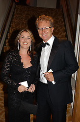 TV presenter MARK CURRY and SUSIE HOMES at The Caron Keating Foundation Dinner in honour of the late TV presenter who died in April 2004, held at The Savoy, London on 4th October 2004.<br />