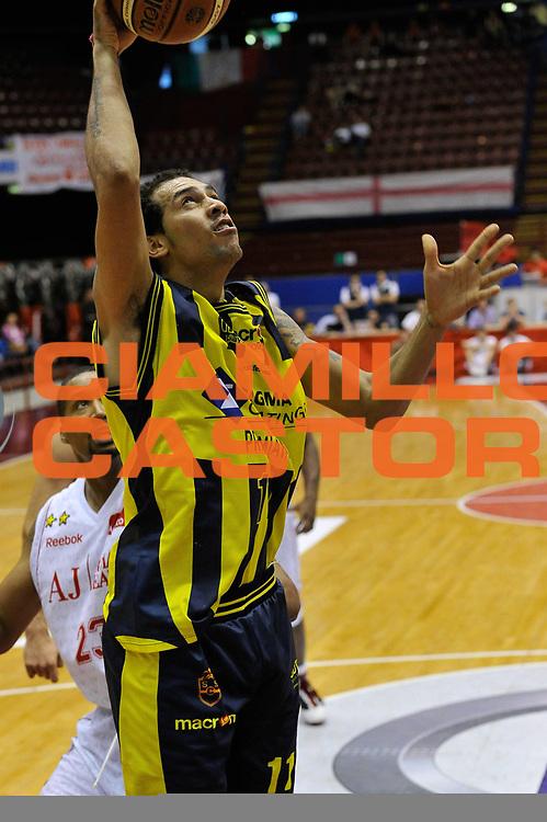 DESCRIZIONE : Milano Lega A 2009-10 Playoff Quarti di Finale Gara 2 AJ Milano Sigma Coatings Montegranaro<br /> GIOCATORE : Marcus Marquinhos<br /> SQUADRA : Sigma Coatings Montegranaro<br /> EVENTO : Campionato Lega A 2009-2010 <br /> GARA : AJ Milano Sigma Coatings Montegranaro<br /> DATA : 22/05/2010<br /> CATEGORIA : Tiro<br /> SPORT : Pallacanestro <br /> AUTORE : Agenzia Ciamillo-Castoria/DomenicoPescosolido<br /> Galleria : Lega Basket A 2009-2010 <br /> Fotonotizia : Siena Lega A 2009-10 Playoff Quarti di Finale Gara 2 AJ Milano Sigma Coatings Montegranaro<br /> Predefinita :