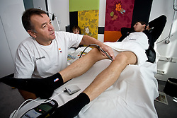 Physiotherapist  Teo Djekic, Matjaz Smodis  and Goran Dragic of Slovenia at a rehabilitation in a Andel's Hotel during Eurobasket 2009, on September 15, 2009 in  Lodz, Poland.  (Photo by Vid Ponikvar / Sportida)