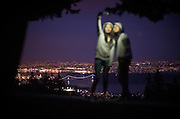 Visitors pose for a selfie overlooking the downtown in West Vancouver, BC. (2014)
