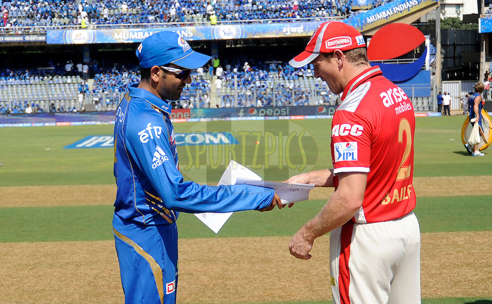 Rohit Sharma captain of the Mumbai Indians and George Bailey of the Kings X1 Punjab during the toss before the start of match 22 of the Pepsi Indian Premier League Season 2014 between the Mumbai Indians and the Kings XI Punjab held at the Wankhede Cricket Stadium, Mumbai, India on the 3rd May  2014<br /> <br /> Photo by Pal Pillai / IPL / SPORTZPICS<br /> <br /> <br /> <br /> Image use subject to terms and conditions which can be found here:  http://sportzpics.photoshelter.com/gallery/Pepsi-IPL-Image-terms-and-conditions/G00004VW1IVJ.gB0/C0000TScjhBM6ikg