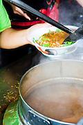 Preparing Assam Laksa at Kim Laksa.