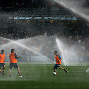 Santi Cazorla, Juan Mata and Cesc Fabregas, Spain,  as the sprinklers are turned on at half time as they warm up during the Spain V Ireland International Friendly football match at Yankee Stadium, The Bronx, New York. USA. 11th June 2013. Photo Tim Clayton