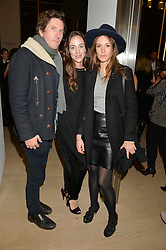 Left to right, CHRIS TAYLOR, LILY HANBURY and CAROLINE LEVER at an evening of Fashion, Art & design hosted by Ralph Lauren and Phillips at the new Phillips Gallery, 50 Berkeley Square, London on 22nd October 2014.