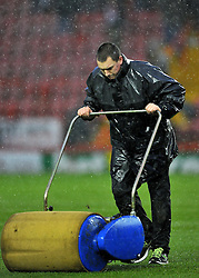 Bristol city Ground Staff work tirelessly to clear the pitch, but Referee Michael Taylor called the game off - Photo mandatory by-line: Joe Meredith/JMP  - Tel: Mobile:07966 386802 26/12/2012 - Bristol City v Watford - SPORT - FOOTBALL - Championship -  Bristol  - Ashton Gate Stadium -