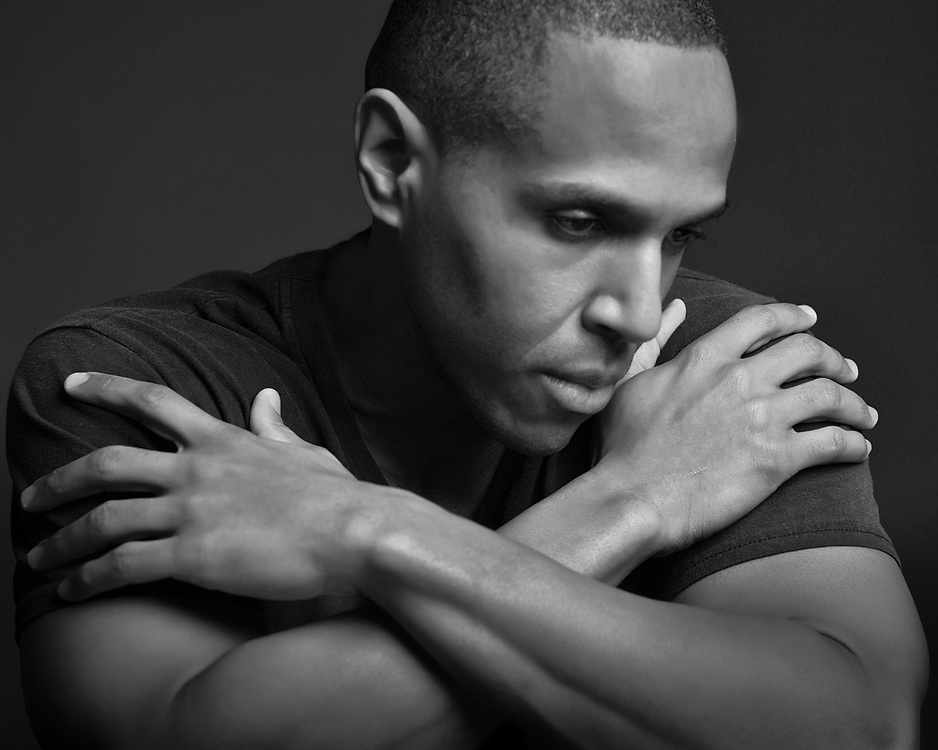 Introspective black and white portrait of African-American actor/director.