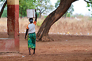 A lady collects water in Ghana.