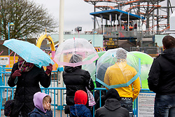 © Licensed to London News Pictures.09/04/2012, Skegness, North Lincolnshire, UK. Bank Holiday Monday weather, Skegness sea front.Pictured, Brolly weather on a rainy Skegness promanade. Photo credit : Dave Warren/LNP