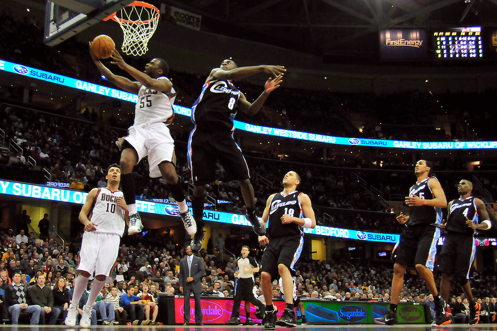 Jan. 21, 2011; Cleveland, OH, USA; Milwaukee Bucks guard Keyon Dooling (55) flys past Cleveland Cavaliers guard Christian Eyenga (8) during the fourth quarter at Quicken Loans Arena. The Bucks beat the Cavaliers 102-88. Mandatory Credit: Jason Miller-US PRESSWIRE