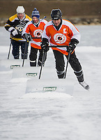 First day of tournament action at the New England Pond Hockey Classic on Meredith Bay Friday, February 1, 2013.  Karen Bobotas/for the Laconia Daily Sun