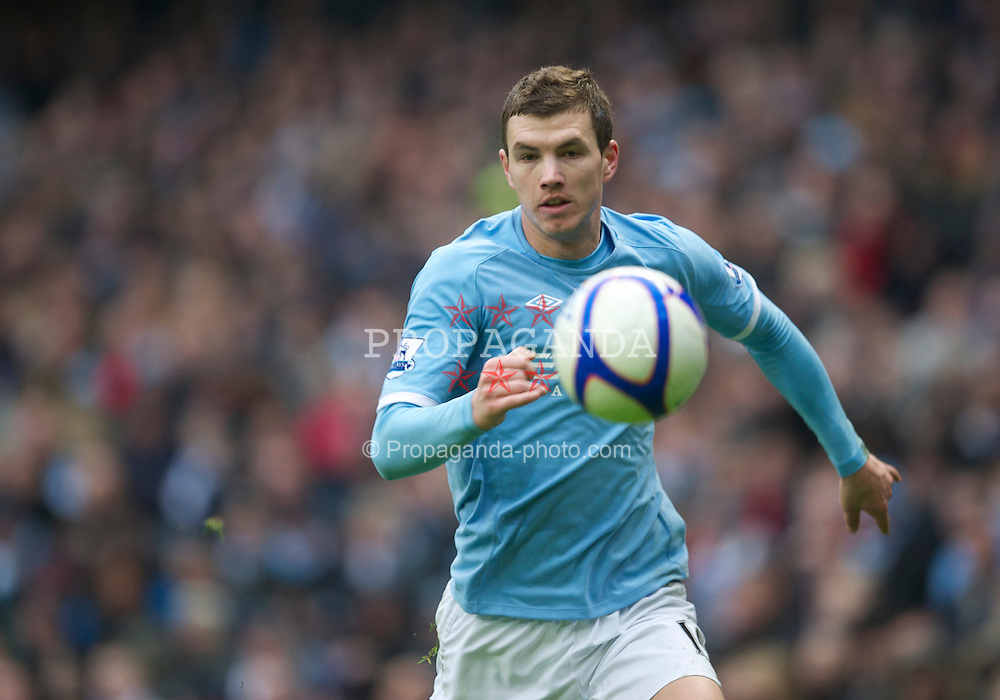 MANCHESTER, ENGLAND - Sunday, February 20, 2011: Manchester City's Edin Dzeko in action against Notts County during the FA Cup 4th Round Replay match at the City of Manchester Stadium. (Photo by David Rawcliffe/Propaganda)