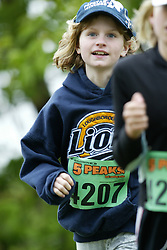 "(Kingston, Ontario---16/05/09) ""Brandy Treadgold running in the kids race at the 2009 Salomon 5 Peaks Trail Running series Race held in Kingston, Ontario as part of the Eastern Ontario/Quebec division. ""  Copyright photograph Sean Burges / Mundo Sport Images, 2009. www.mundosportimages.com / www.msievents.com."