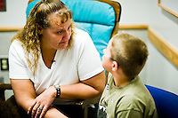 Corey Haas, 8, talks with his mother, Nancy, before he enters surgery at the UPenn Medical Center in Philadelphia, PA on Thursday, September 25, 2008. Corey is sight-impaired and will undergo surgery injecting genetic material into his left eye in hopes of improving his vision.