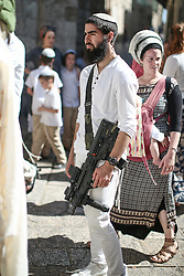 A Jewish settler with a machine gun in East Jerusalem. From a series of photos commissioned by  British NGO, Medical Aid for Palestinians (MAP).