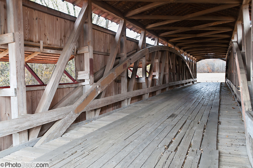 A Burr Arch Truss supports Neet Covered Bridge (126 feet long), built in 1904 by J.J. Daniels over Little Raccoon Creek, on Bridgeton Road, Parke County, Indiana, USA.