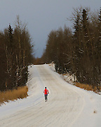 Alaska, Anchorage, Old Seward Highway, Person running on Old Seward Highway