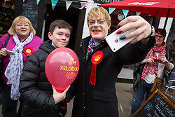 © Licensed to London News Pictures . 17/04/2015 . Chester , UK . People queue up to pose for selfies with EDDIE IZZARD as he joins Labour candidate Chris Matheson , campaigning in the City of Chester constituency . Photo credit : Joel Goodman/LNP