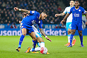 Newcastle United forward Ayoze Perez (17) tackles Leicester City defender Danny Simpson (17)  during the Barclays Premier League match between Leicester City and Newcastle United at the King Power Stadium, Leicester, England on 14 March 2016. Photo by Simon Davies.
