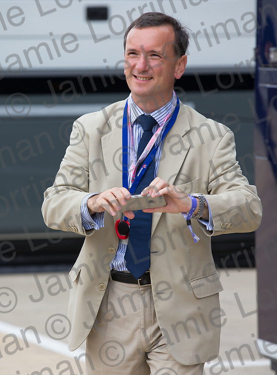 The 2017 Formula 1 Rolex British Grand Prix at Silverstone Circuit, Northamptonshire.<br /> <br /> Pictured: Secretary of State for Wales Alun Cairns takes a photograph in the F1 paddock at Silverstone.<br /> <br /> Jamie Lorriman<br /> mail@jamielorriman.co.uk<br /> www.jamielorriman.co.uk<br /> +44 7718 900288