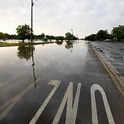 "A portion of ""A"" St. that runs alongside Wadley Barron Park in Midland, TX is partially submerged after the pond there overflowed due to excess rainfall."