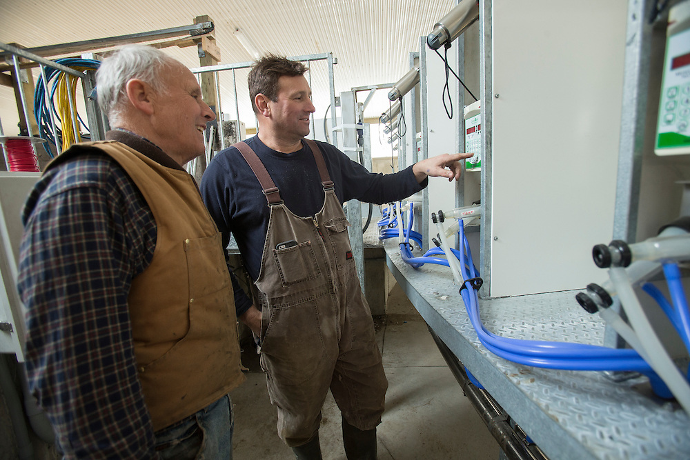 Dairy goat farmers Leo Donkers, left, and his son Ed check over their new rotary milking parlour on their farm near Shedden, Ontario, Monday,  February 2, 2015.<br /> Farmers Forum/ Geoff Robins