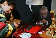 Year 6 pupil using a microscope on an exhibit about germs at the Thackray Medical Museum in Leeds....